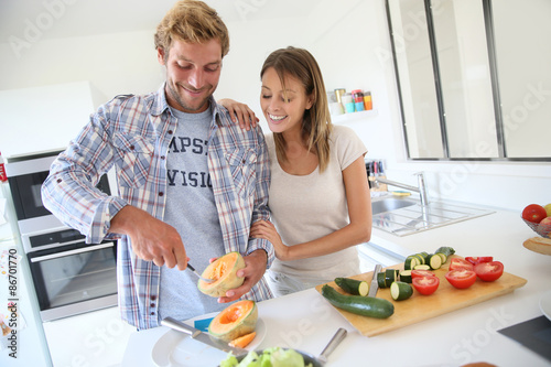 Fotografie, Obraz  Couple in kitchen preparing lunch together