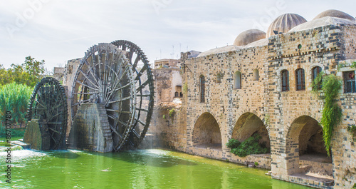 Poster Moyen-Orient Noria of Hama, water wheel along the Orontes River in the city of Hama, Syria.