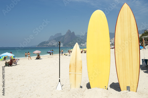 obraz lub plakat Surfboards and stand up paddle boards line up on the beach at Arpoador, Ipanema, Rio de Janeiro Brazil