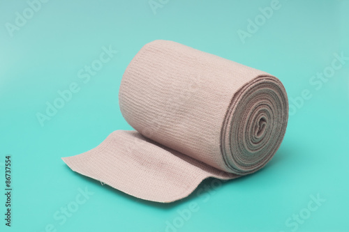 Medical Bandage Roll on Turquoise Background Canvas Print