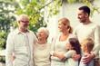 Leinwandbild Motiv happy family in front of house outdoors