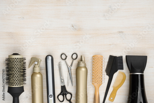 Fotografie, Obraz  Hairdressing tools on wooden background with copy space at top