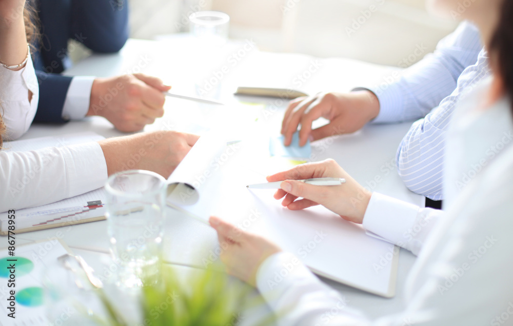 Fototapeta Image of business people hands working with papers at meeting