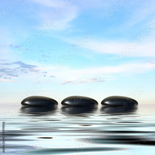Deurstickers Zen Zen spa concept background-Zen black massage stones reflected in water
