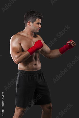 Man practicing body combat - Buy this stock photo and