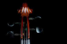 Violin Scroll On Black Background