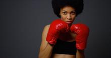 Black Woman Boxer Punching Tow...