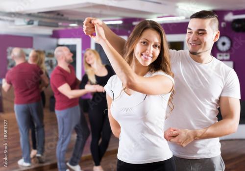 Photographie Happy adult couples enjoying of partner dance indoor
