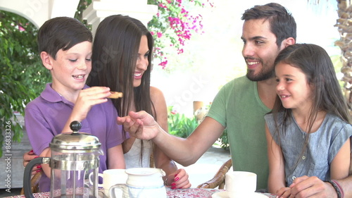 Photo  Family Eating Breakfast Outdoors Together