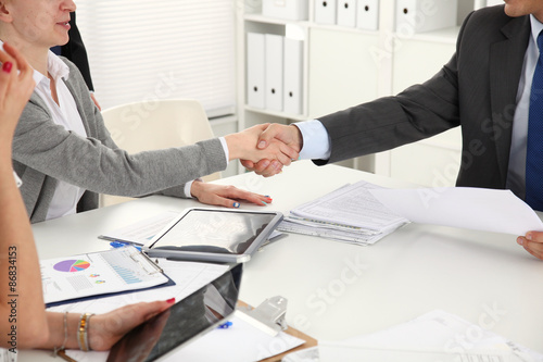 Fototapety, obrazy: Business people shaking hands, finishing up a meeting