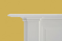 Simplistic White Fireplace Mantle Against Yelllow Wall