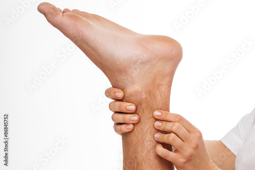 Physiotherapist palpating Achilles tendon Canvas Print