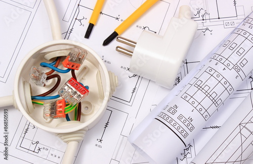 Photo  Electrical box, diagrams and electric plug on construction drawing