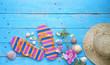 Summer sunbathing beach vacation concept, flip flops, seashells,