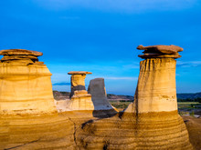 Hoodoos Bathed In The Warm Light Of A Summer Sunset At Drumheller Alberta Canada.