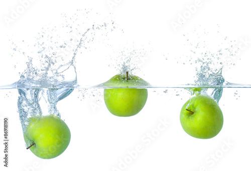 Fotografie, Obraz  Äpfel klesla ins Wasser mit Spritzern