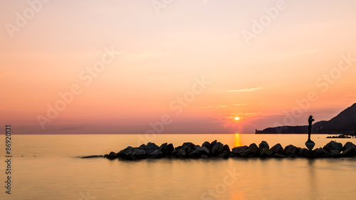 Papiers peints Corail sunset behind the castle of Trieste