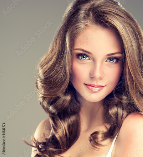 Fotografie, Obraz  Beautiful young girl with long hairstyle curly hair