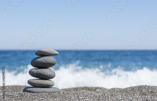 Acrylic Prints Stones in Sand Balance stones on the beach. Selective focus