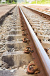 Straight-line railway tracks on the gravel with realistic rusty rails