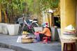 Vietnamese women selling food on the street of Hoi An, Vietnam