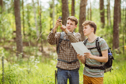 two tourist determine the route map and navigator