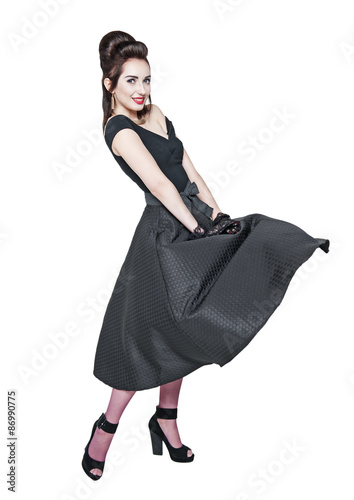 Photo  Young beautiful woman in retro pin-up style with fluttering dress