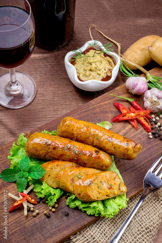 Fototapety, obrazy: Grilled sausage with vegetables and mustard