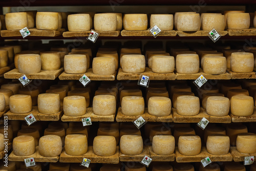 Poster Produit laitier wheels of cheese in a maturing storehouse dairy cellar