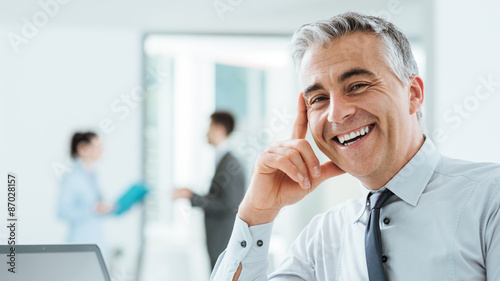 Fototapeta  Confident corporate businessman portrait