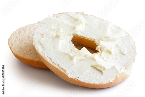 Fotografie, Obraz  Plain bagel cut in half and spread with cream cheese
