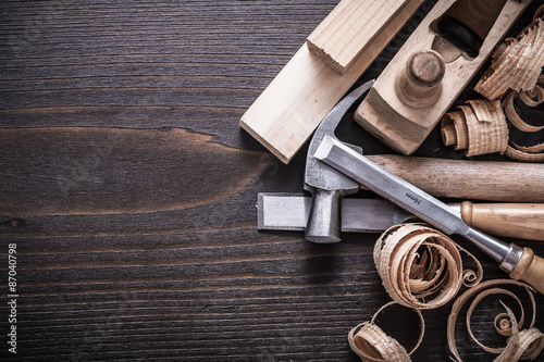 Planer claw hammer firmer chisels wooden bricks and curled shavi Fototapet