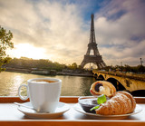 Fototapeta Paryż - Coffee with croissants against Eiffel Tower in Paris, France