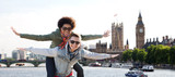 Fototapeta London - happy teenage couple having fun over london city
