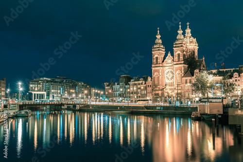 Photo  Night Amsterdam canal and Basilica Saint Nicholas