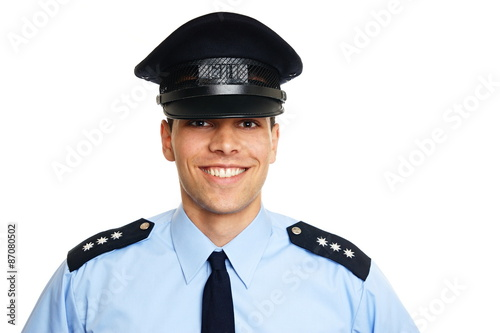 Photo Smiling young policeman on white background