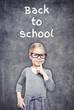 Smart beautiful little girl on the chalkboard background