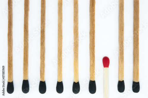 Photo Think different from group, one red matchbox stick turn opposite way with all bl