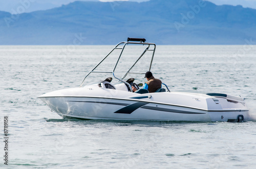 Poster Nautique motorise boat on the waves