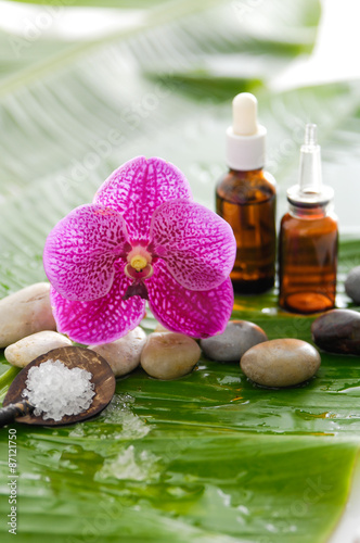 Deurstickers Spa spa setting with pebbles ,stones,oil , orchid and banana leaf