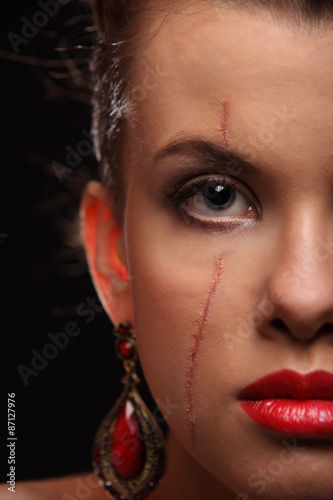 Photo  beautiful girl with a scar on face and shoulder