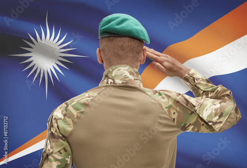 Fotografía  Dark-skinned soldier with flag on background - Marshall Islands