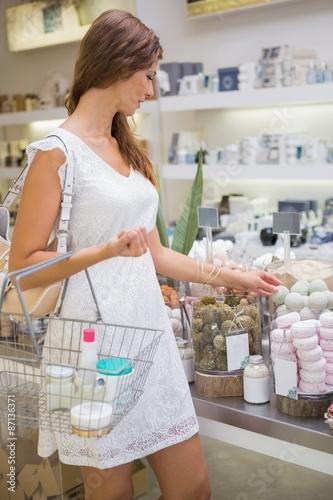 Foto op Plexiglas Bakkerij Woman with shopping basket testing soap