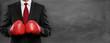 canvas print picture - Mann im Anzug mit Boxhandschue