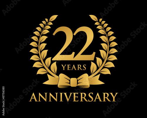 anniversary logo ribbon wreath black background 22 buy this stock