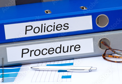 Valokuva  Policies and Procedure - two binders in the office