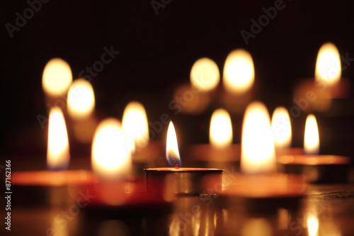 Fotografie, Obraz  Candles light select focus, black background.