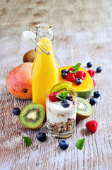 Yogurt with granola with berries and fruits, for healthy breakfast, selective focus