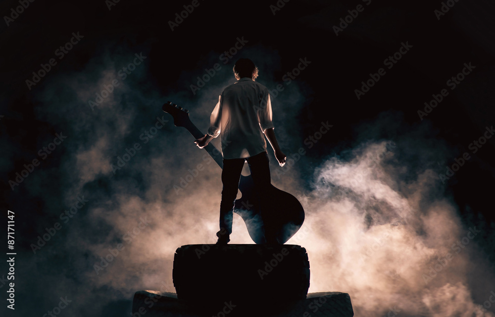 Fototapety, obrazy:  Rock musician and large guitar, a lot of smoke