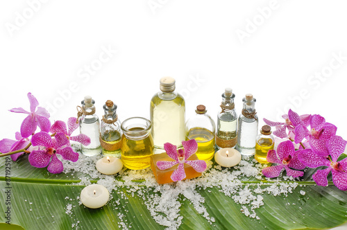 Deurstickers Spa spa supplies with orchid,oil, candle on banana leaf